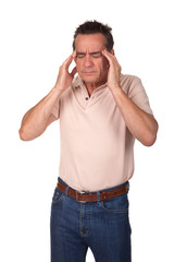 Middle Age Man with Headache Holding Head in Pain