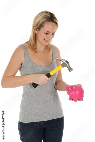 Girl Opening Piggy Bank with Hammer