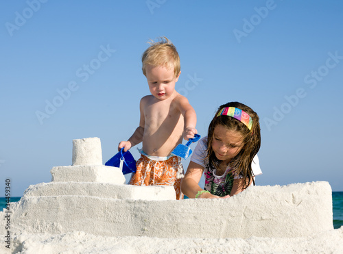 Kids Building Sandcastle on a Beach