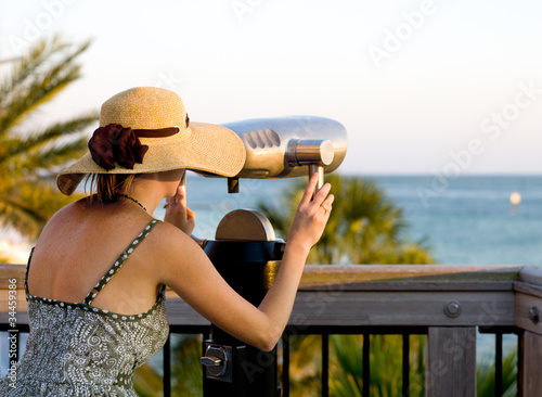 Woman Looking Trough Telescope