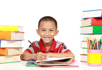 happy kid smiling while studying against white background
