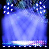 Fototapety Blue spotlight background with light show effects.