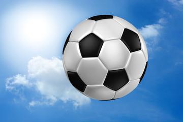 Football against blue sky