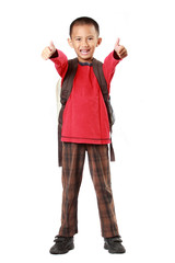 Portrait of boy with backpack smiling showing thumb up sign agai