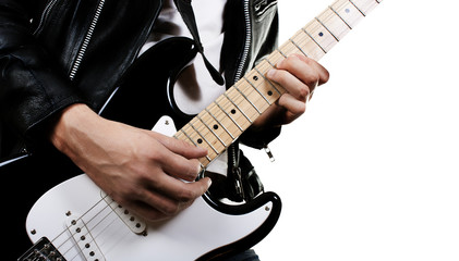 Guitarist playing on electric guitar