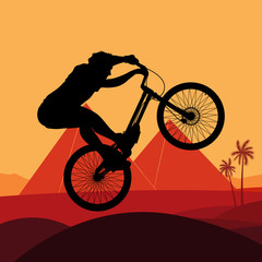 Animated mountain bike trial rider in Egypt pyramid illustration