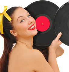 beauty smiling young woman with vinyl discs