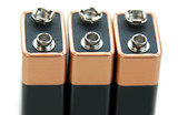 Three nine volt batteries isolated on white background poster