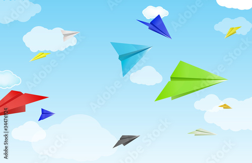 colorful paper planes on sky and cloud background