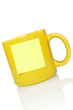 yellow cup with note sticker for your text.