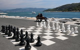 outd chessboard painted on boulevard on italian riviera poster