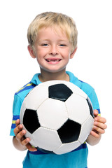 Boy holds soccer ball