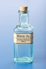 Nitric acid in small chemical bottle