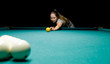 woman plays russian billiards