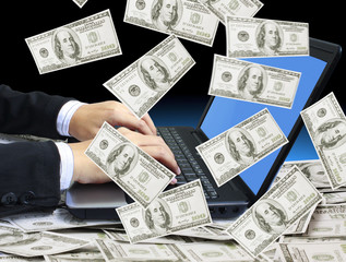 dollars appears from the laptop screen
