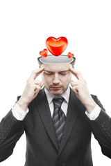 Open minded man with hearts inside thinking about it