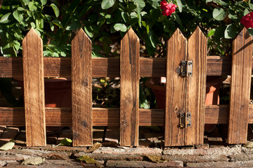 wooden fence at garden under sunshine