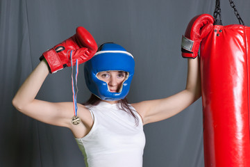 Boxing training woman with punching bag in gym wear gloves