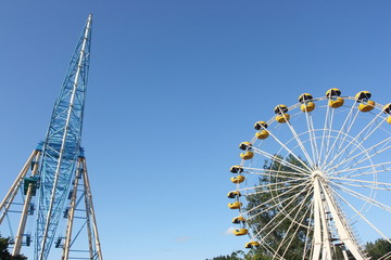 Ferris wheel against a blue sky in the amusement park