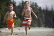 boys running at a beach