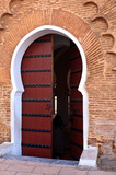 Detail of an ornate wooden door outside a riad poster