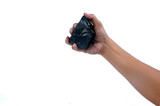 male hand holding a little lump of coal