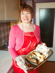 Woman with cooked scomber