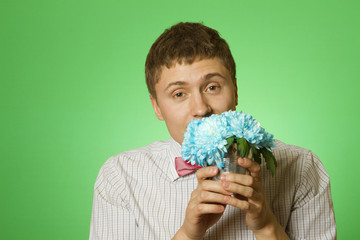 "Lover man ""nerd"" with a bouquet of flowers"