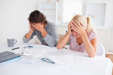 Worried couple doing accounts