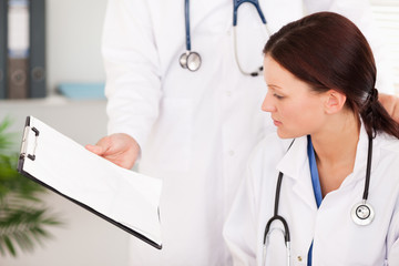 Doctor showing female doctor file