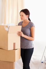 Woman packing a cardboard