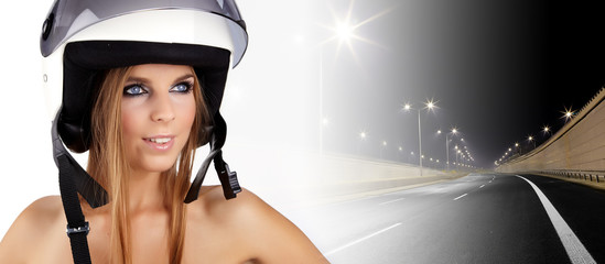 Sexy woman with a white motrcycle helmet and surprised expressio