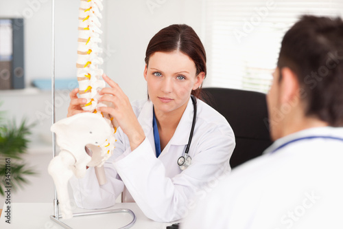 Female doctor touching spine