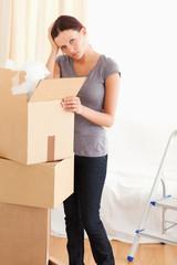 A female packing a cardboard