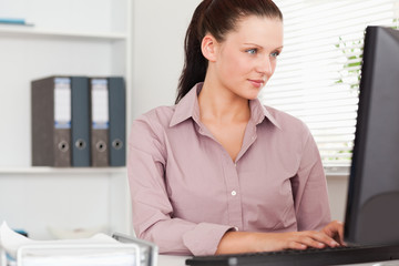 Businesswoman focusing on screen