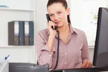 Telephoning businesswoman in her office