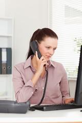 Focused businesswoman with telephone