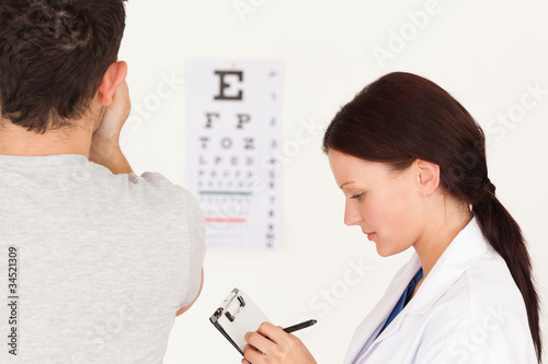 Female optician and patient