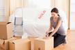Female preparing cardboards for transport