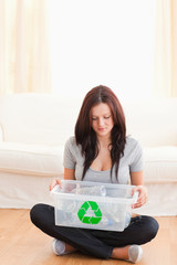 Woman with recycling bin