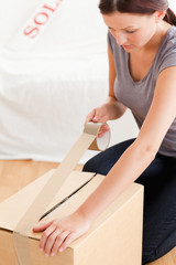 Woman preparing cardboard for transport