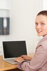 A businesswoman at notebook