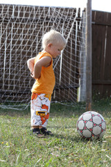 Boy stands in football goals