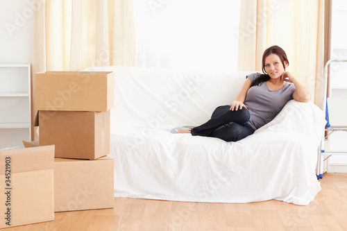 Cute woman sitting on a couch