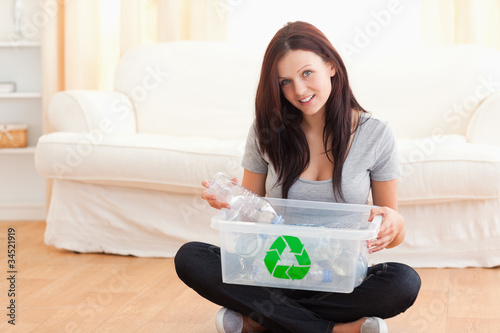 Cute woman with a recycling box