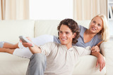 Cute young couple watching TV