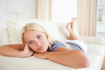 Calm woman posing lying