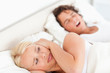 Annoyed woman awaken by her fiance's snoring