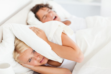 Woman awaken by her husband's snoring