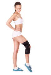 Girl with trauma of knee in brace.